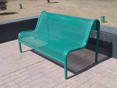 A chair and a garbage can are made of green or white painting perforated sheet metal.