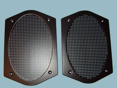Two black oven grilles with uniform perforated round holes.